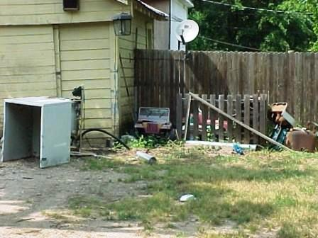 Junked toys & appliances in yard
