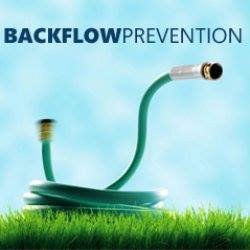 Backflow Prevention (picture of water hose in grass)